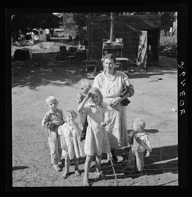 Family living in shacktown community, mostly from Kansas and Missouri. This family has five children, oldest in third grade. Rent seven dollars per month, no plumbing. Husband working on Work Projects Administration wages, forty four dollars.  1939 August.