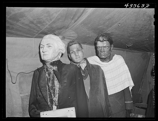 Effigies of Washington, Joe Louis and some criminal in a travelling sideshow crime museum. Washington and Joe Louis are examples of what you may become if you go straight. Near Fort Bragg, North Carolina