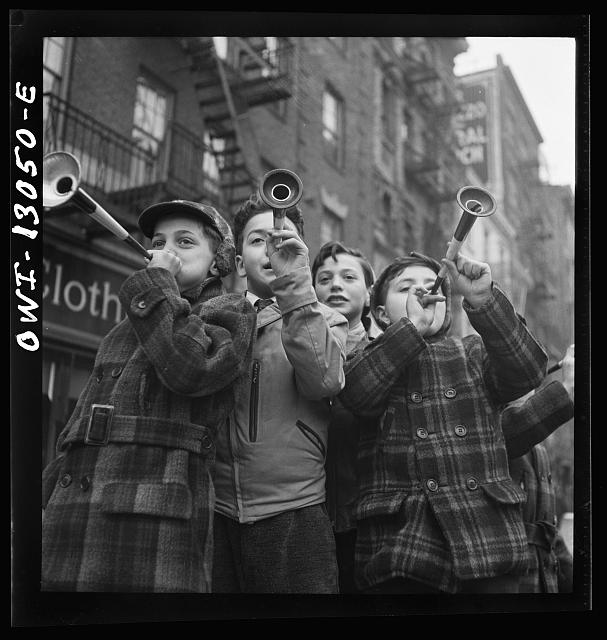 New York, New York. Blowing horns on Bleeker Street on New Years Day.  January 1943.
