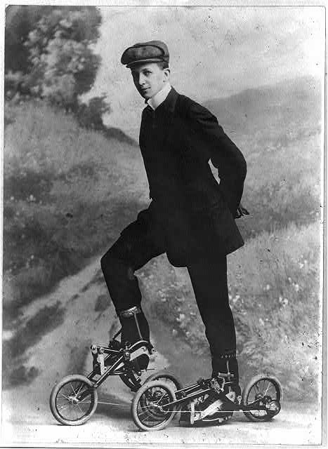 Young man on roller skates that are pedaled  1910 Nov. 8.