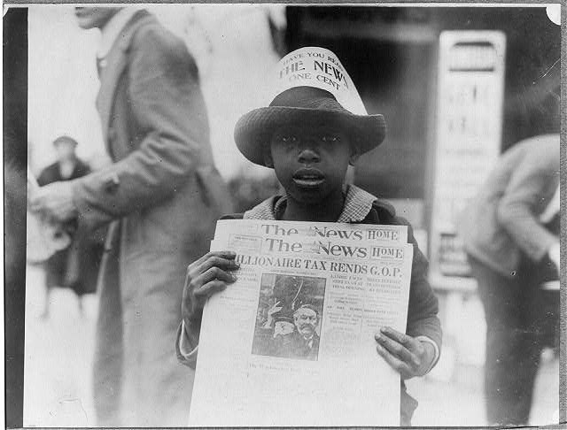 African American boy selling The Washington Daily News - sign on his hat reads, Have you read The News? One cent - headline reads Millionaire tax rends G.O.P.  8 November 1921