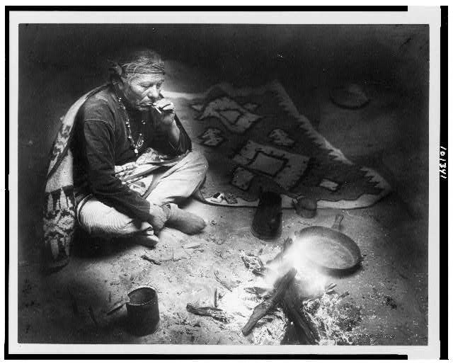 After dinner smoke Photograph copyrighted by William J. Carpenter, 1915.