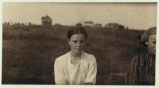 Mildred Griffiths, 9 Pleasant St., 13 yrs. old. A regular packer in Blanchards Sardine Factory. Makes $1.00 to $2.00 a day. Sometimes works until midnight. Location: Eastport, Maine.  1911 August (Photo: Lewis Wickes Hine)