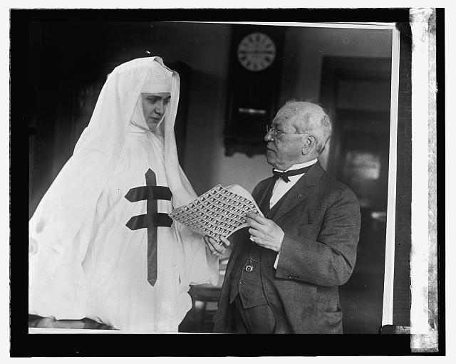 Samuel Gompers buying Christmas seals in 1923.