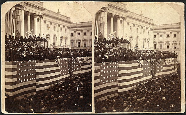Chief Justice Morrison R. Waite administering the oath of office to Rutherford B. Hayes, 19th President of the United States (1877 - 1881), on a flag-draped inaugural stand on the east portico of the U.S. Capitol (1877)