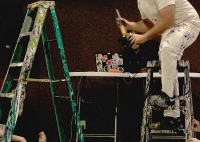 Artist Paul Coté performs a live painting exhibition at the Driftwood IV Art Gala for Alzheimer's.