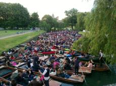 Punts fill River Cam in preparation for the famous fireworks show. June 17, 21:20 (over one hour before the show itself). Trinity's territory is on both sides of the river, and bulky security guards ensure that punters don't climb out and crash the Ball.
