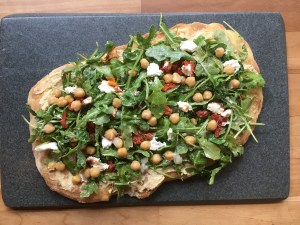 Grilled Thin Crust Pizza with Hummus, Arugula, Sun-dried Tomato, Goat Cheese and Chickpeas