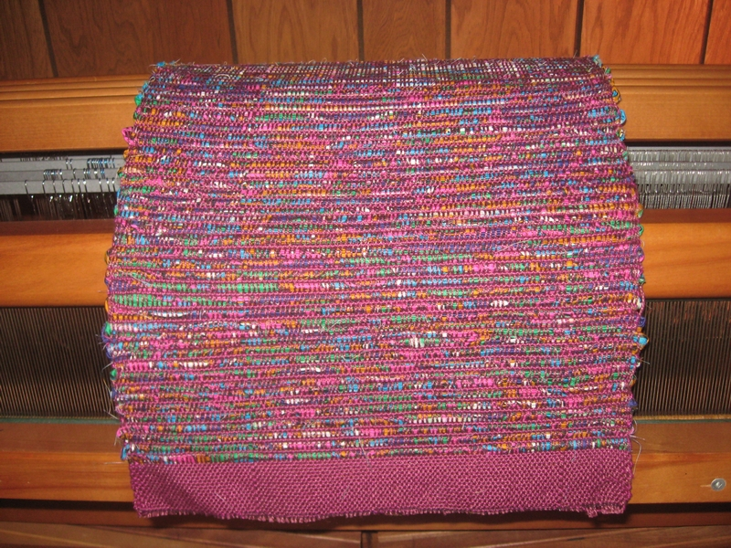 Handwoven sample made from strips cut from fabric at left