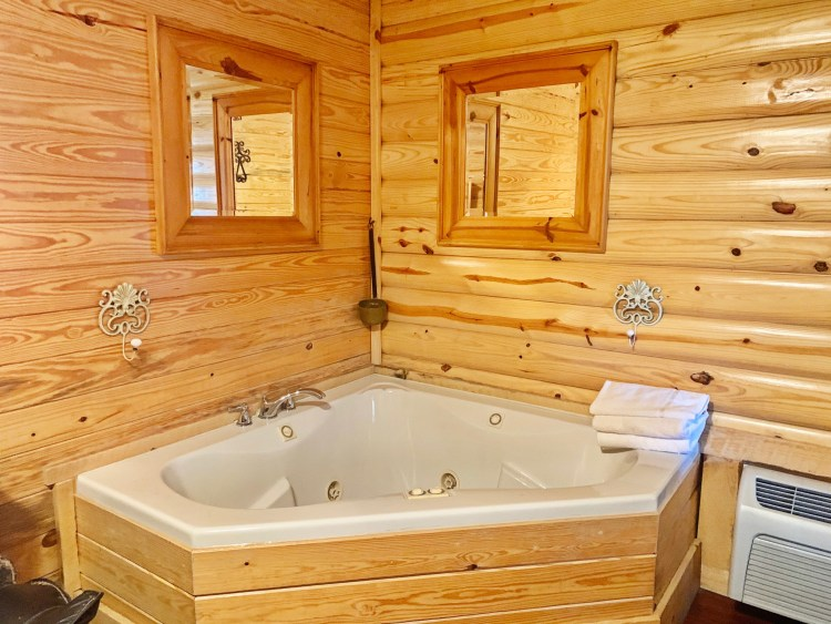 Jacuzzi tub in rustic couples cabin