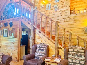 Rustic wood staircase in two story cabin