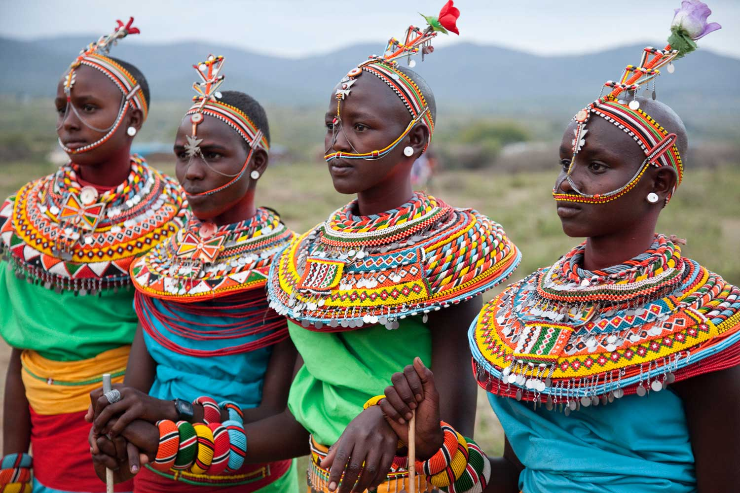 Marcy Mendelson, The Samburu Story | Young Samburu women in their finest decorations at the Lmuget dance show why many refer to the Samburu as 'The Butterfly People'.