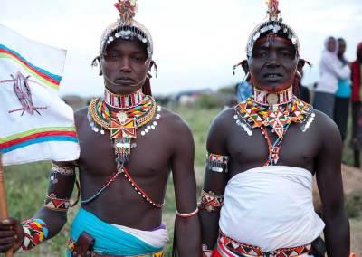 Marcy Mendelson, The Samburu Story | Samburu moran (warriors) celebrate their graduation into 'senior' moran status of the Loimisi clan.  Outside Kisima village, Samburu, Kenya.