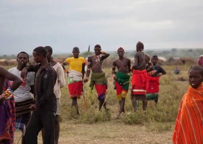 Marcy Mendelson, The Samburu Story | Samburu moran (warriors) relax and celebrate following their graduation ceremony into senior warrior status.  Outside Kisima village, Samburu, Kenya.  August 22, 2013.