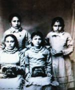 These beautiful little girls are the Freniere sisters. The girl in the front left may be Rosalie Freniere. Does anyone know these girls names?