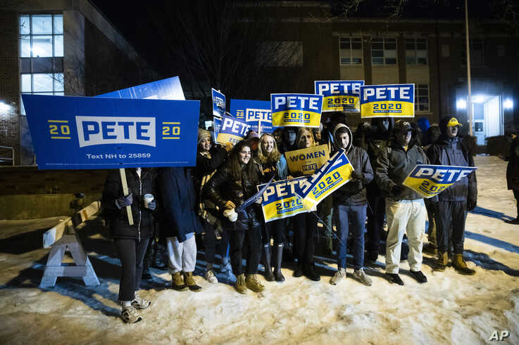 Supporters of Democratic presidential candidate former South Bend, Ind., Mayor Pete Buttigieg gather outside a polling place…