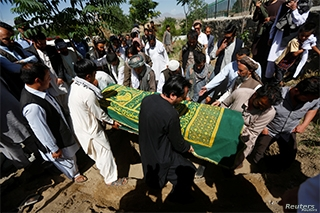 FILE - Afghans take part in a burial ceremony of a journalist, in Kabul, Afghanistan, June 7, 2016. Local radio journalist Nader Shah Sahibzada was found dead Saturday near his home in Gardiz, in Afghanistan's Paktia province.