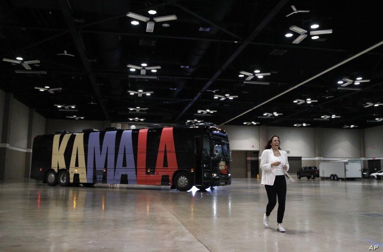 Democratic presidential candidate Sen. Kamala Harris, D-Calif., enters a rally, Aug. 12, 2019, in Davenport, Iowa.