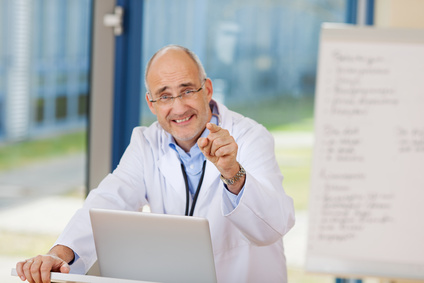 male fertility specialist making a hand pointing gesture