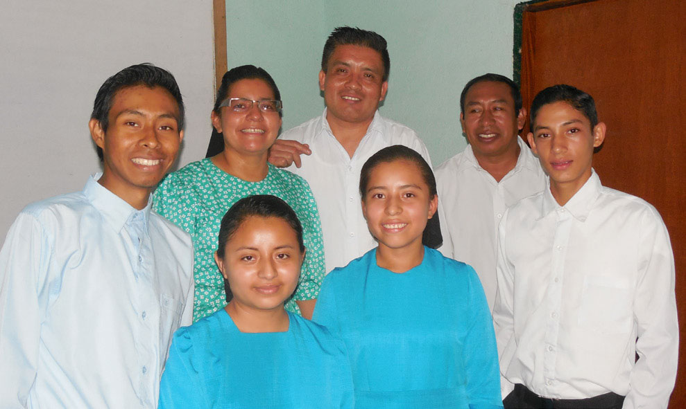 Kenneth and his wife Benedilda (front left), Marco Antonio and wife Magali (back center), with their daughter Johana in front of them. Edwin (right) with bishop Isaias Muñoz behind him. These were taken into fellowship in Oratorio.