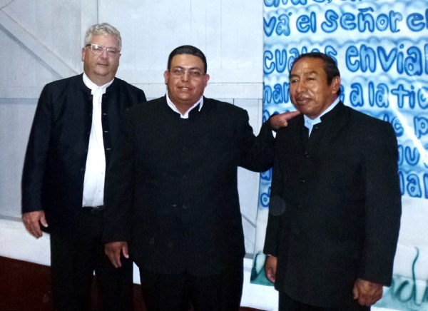 Duane Eby and Isaías Muñoz officiated at the ordination of Donaldo Álvarez (center).