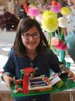 Elisa Burns with her Lego swimming pool which gained her the 7-10 years handicrafts best in class and the handicrafts cup jointly with Lucy McNabb