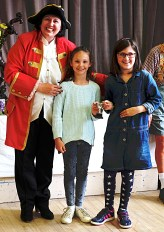 Joint winners of 7-10 years handicrafts cup, Lucy McNabb (left) and Elisa Burns.With town crier.