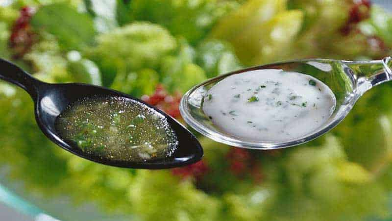 two spoons of salad dressings - unnecessary calories