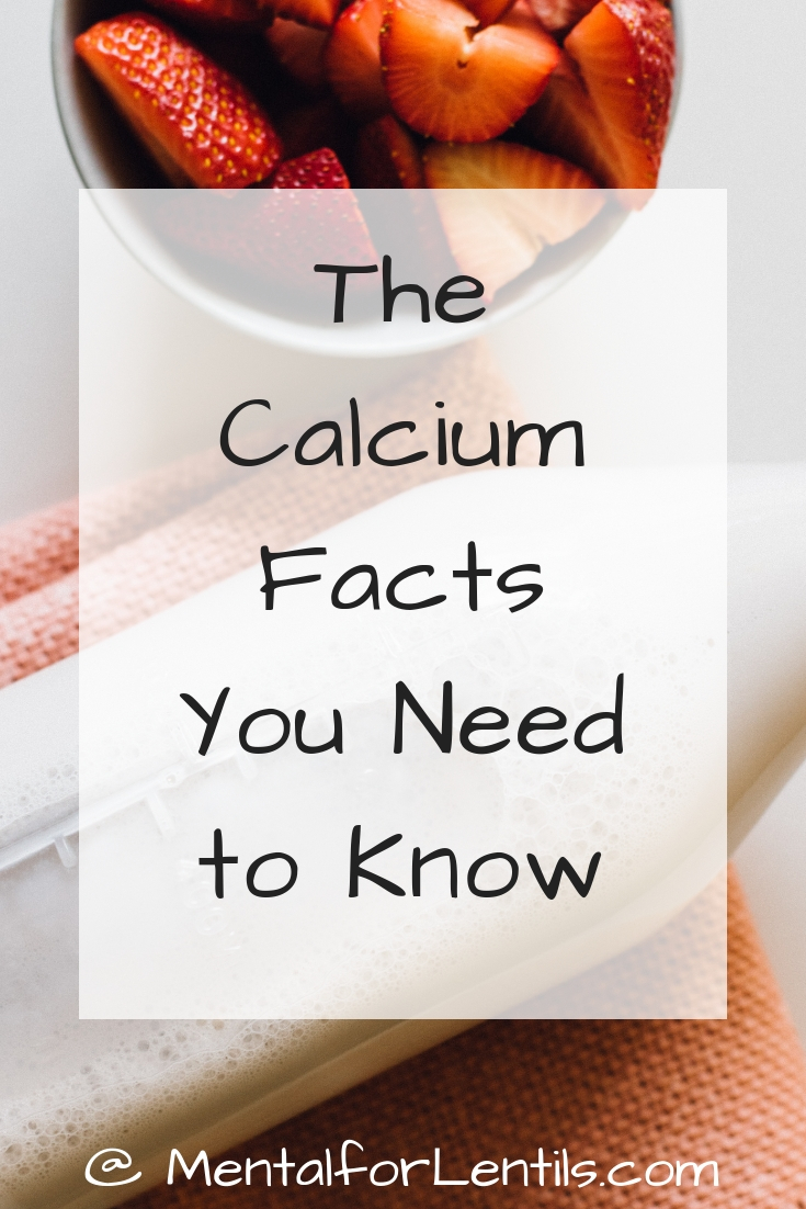 Bottle of milk next to bowl of strawberries with overlay text - The Calcium Facts You Need to Know.