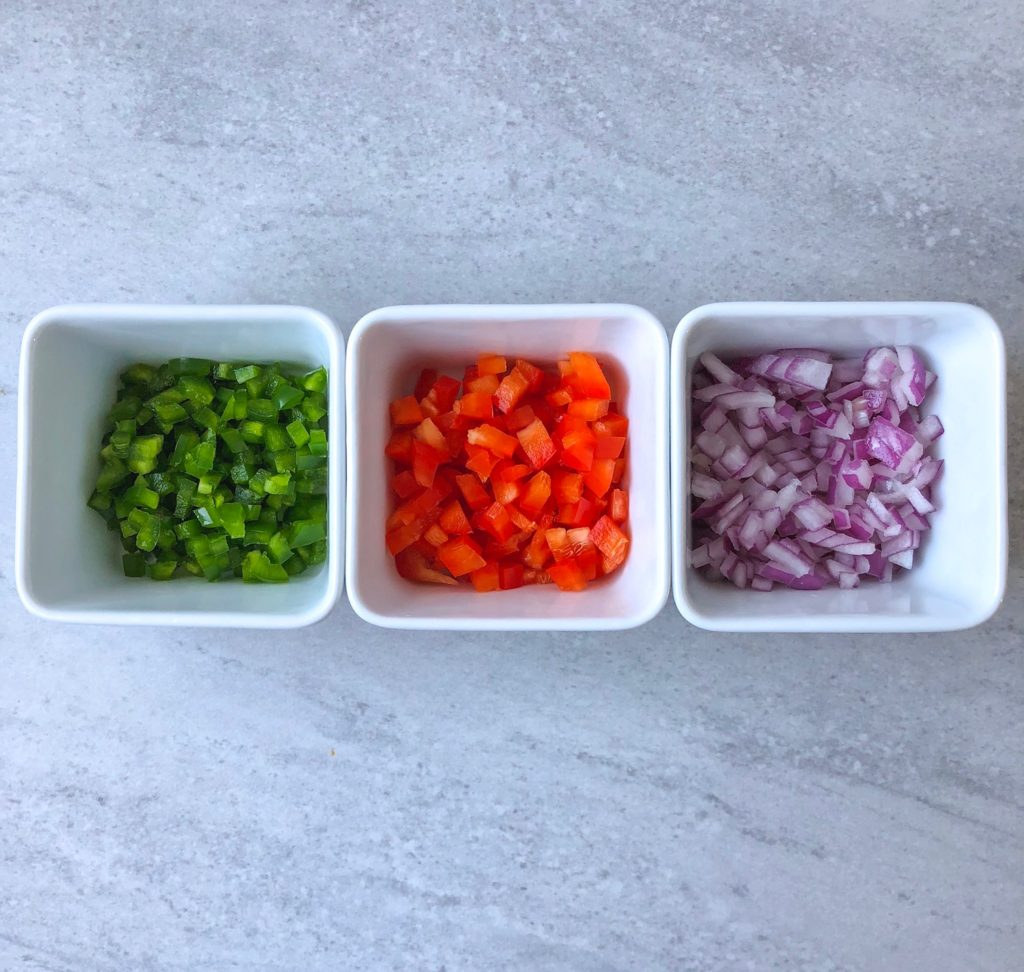 Prep bowls with diced red onion, red pepper and jalapeno