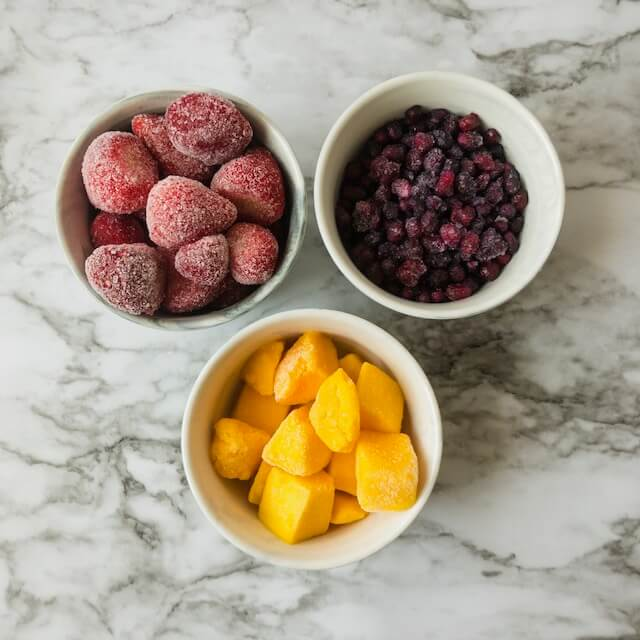 small bowls with frozen fruit
