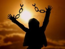 Lit up photo young child holding up broken chains