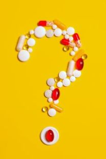 Colour image, yellow background with coloured tablet forming a question mark
