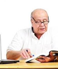 Man reading and following work grievance procedure for bullying.
