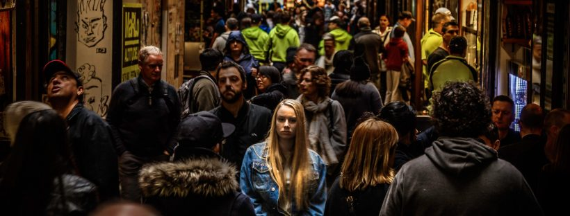 woman standing alone in a crowd
