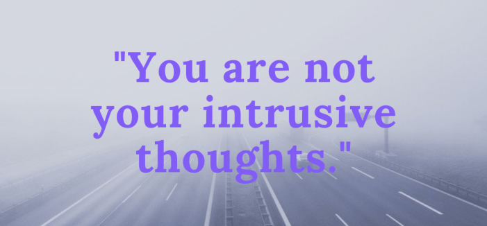 """""""You are not your intrusive thoughts"""" written against a backdrop of a foggy highway"""