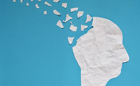 white paper head fragmenting against a blue background
