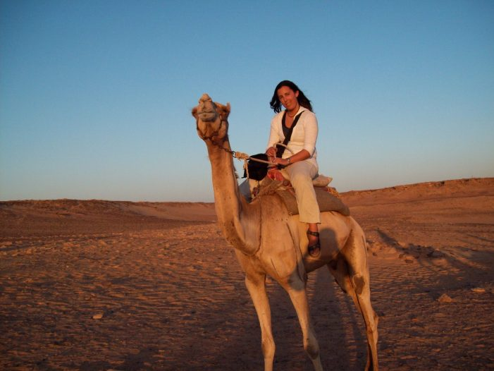 author riding a camel in Egypt