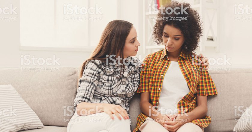women talking on couch