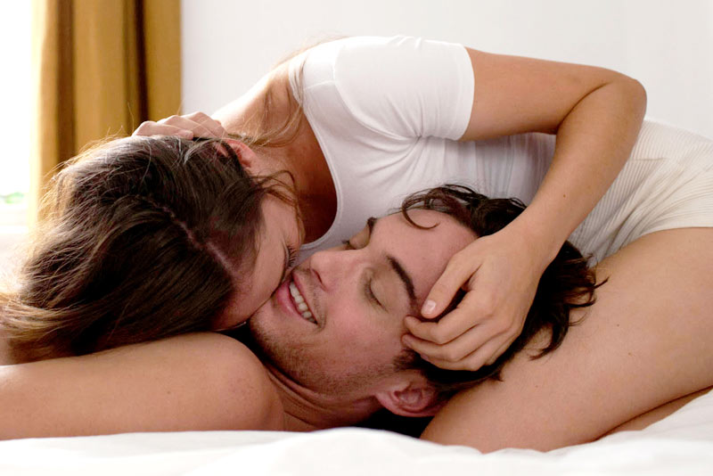 Mental Health Benefits of a Healthy Sex Life - Blog Post Image - Picture of Couple Playing in Bed - Mental Health Foundation