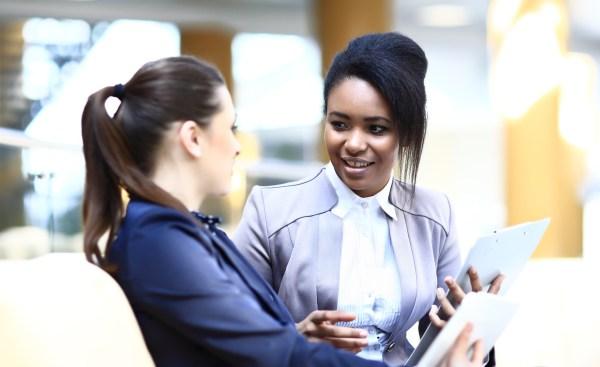 two professional women having a conversation