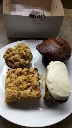 From top left: Apple crumble pie, carrot pumpkin muffin, cinnamon bun, apricot square
