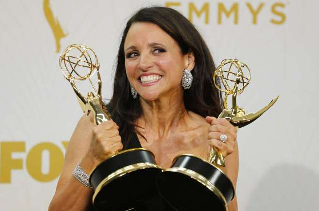 "Actress Julia Louis-Dreyfus holds the awards for Outstanding Lead Actress In A Comedy Series and Outstanding Comedy Series for her role in HBO's ""Veep"" during the 67th Primetime Emmy Awards in Los Angeles, California September 20, 2015. REUTERS/Mike Blake - RTS236C"