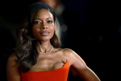 """Naomie Harris poses for photographers on the red carpet at the world premiere of the new James Bond 007 film """"Spectre"""" at the Royal Albert Hall in London"""