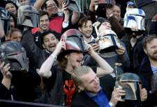 """Fans hold up helmets at the premiere of """"Star Wars: The Force Awakens"""" in Hollywood"""