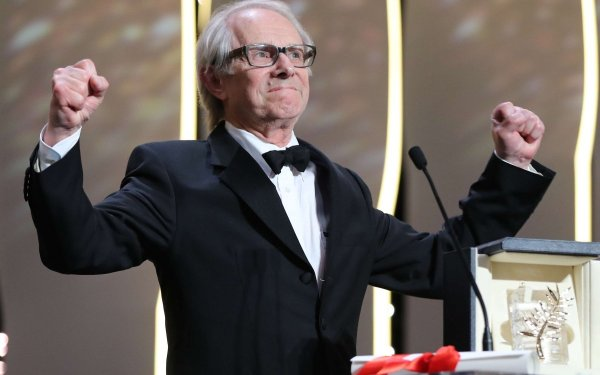 "British director Ken Loach celebrates on stage after being awarded with the Palme d'Or for the film ""I, Daniel Blake"" during the closing ceremony of the 69th Cannes Film Festival in Cannes, southern France, on May 22, 2016. / AFP PHOTO / Valery HACHE"