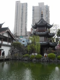 Temple grounds with modern building encroaching, Shanghai