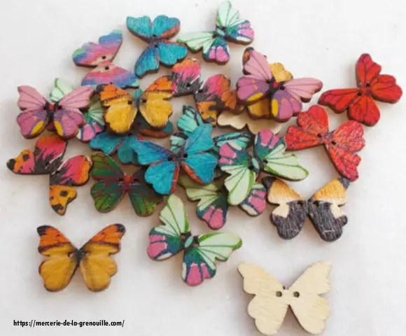 bouton en bois forme papillon