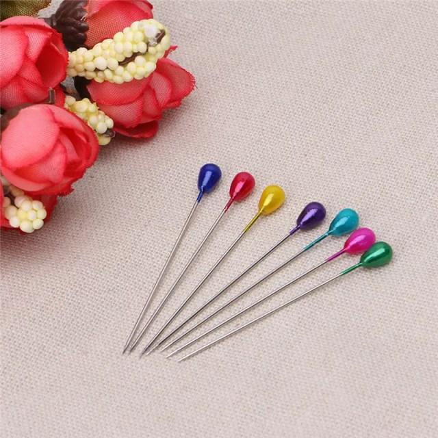 réf 03-03-002 épingle tête perle colorée longue