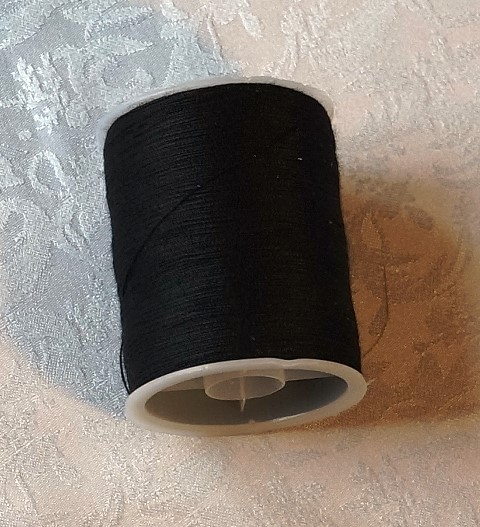 réf 08-u-c-0003 bobine de fil noir